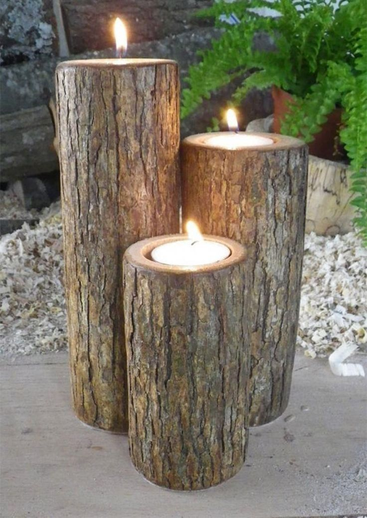 Create outdoor decorative candlesticks with logs
